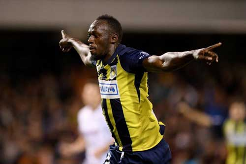 Sprint legend Usain Bolt celebrates after scoring his first goal in professional football on Oct 12.